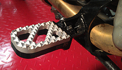 Wide Foot Pegs on BMW GS650 Serato, with Stainless Steel Hunter Tread and Black Base