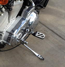 1 inch Lowered Wide Foot Peg on Harley-Davidson Sportster Motorcycle, Black Anodized with Stainless Steel Hunter tread